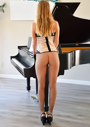 Angelina FTV rides a dildo when playing a piano