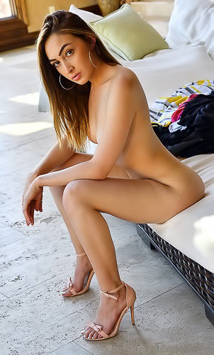 Valentina FTV shoots close-up photos of her shaved cunt
